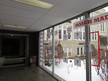The March Madness bracket in the glass hallway.