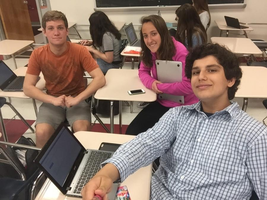 Crimson staff writers Kyle Shalit, Katelin Brito, and Ryan Bali take a selfie using the new invention: Selfie stick