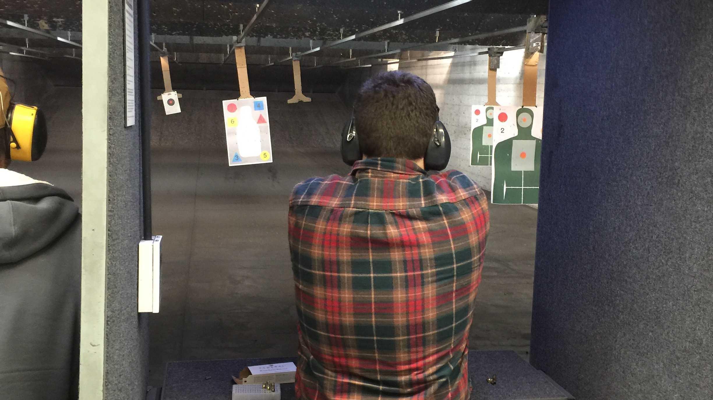 Jake Rosen shoots a Glock at a gun store in Provo, Utah