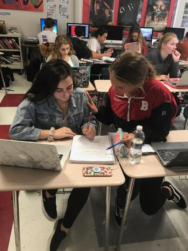 BHS students, Riley Demarrais and Shannon Harzula doing homework