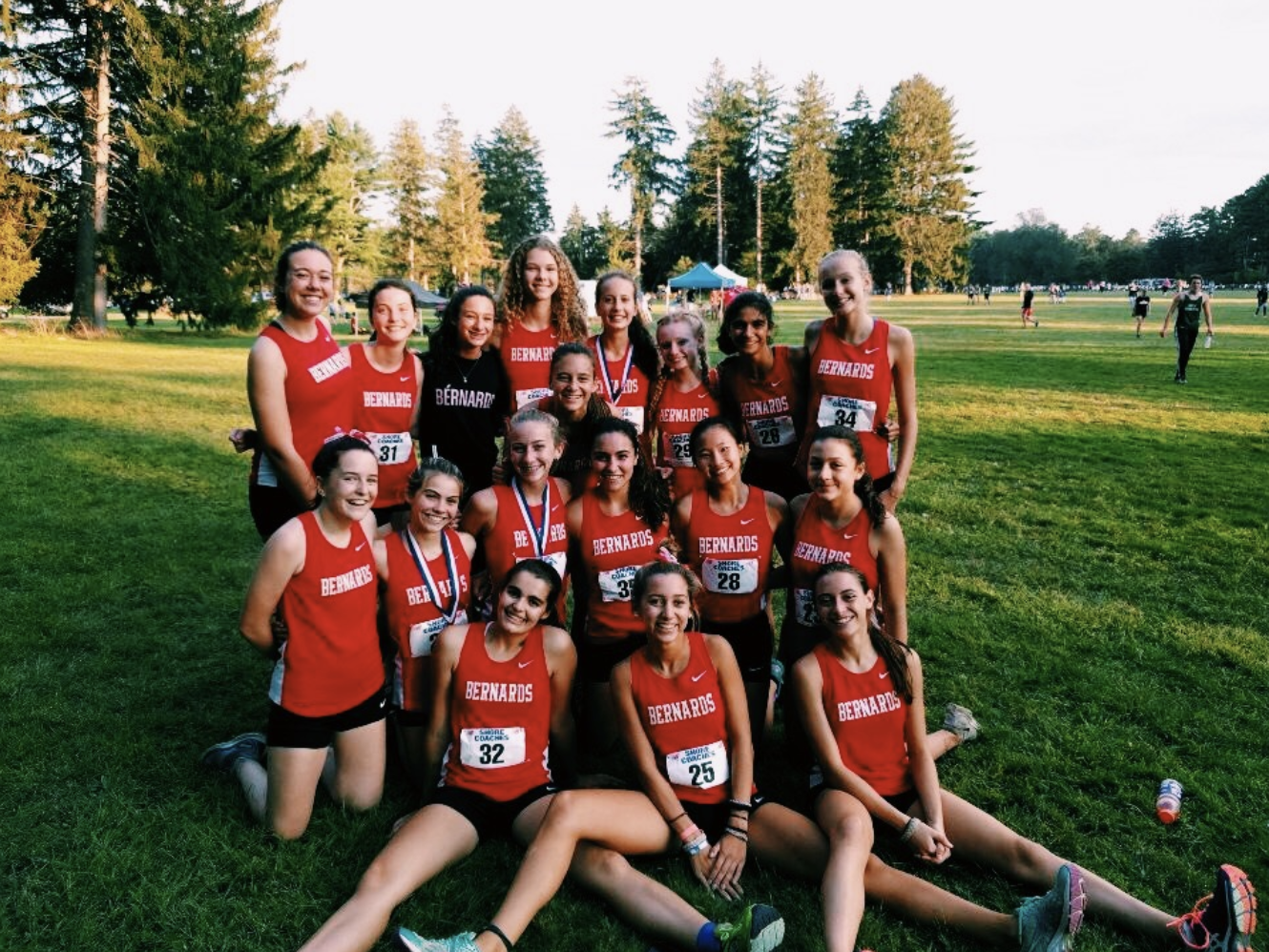 Girls cross country team celebrates after a successful meet