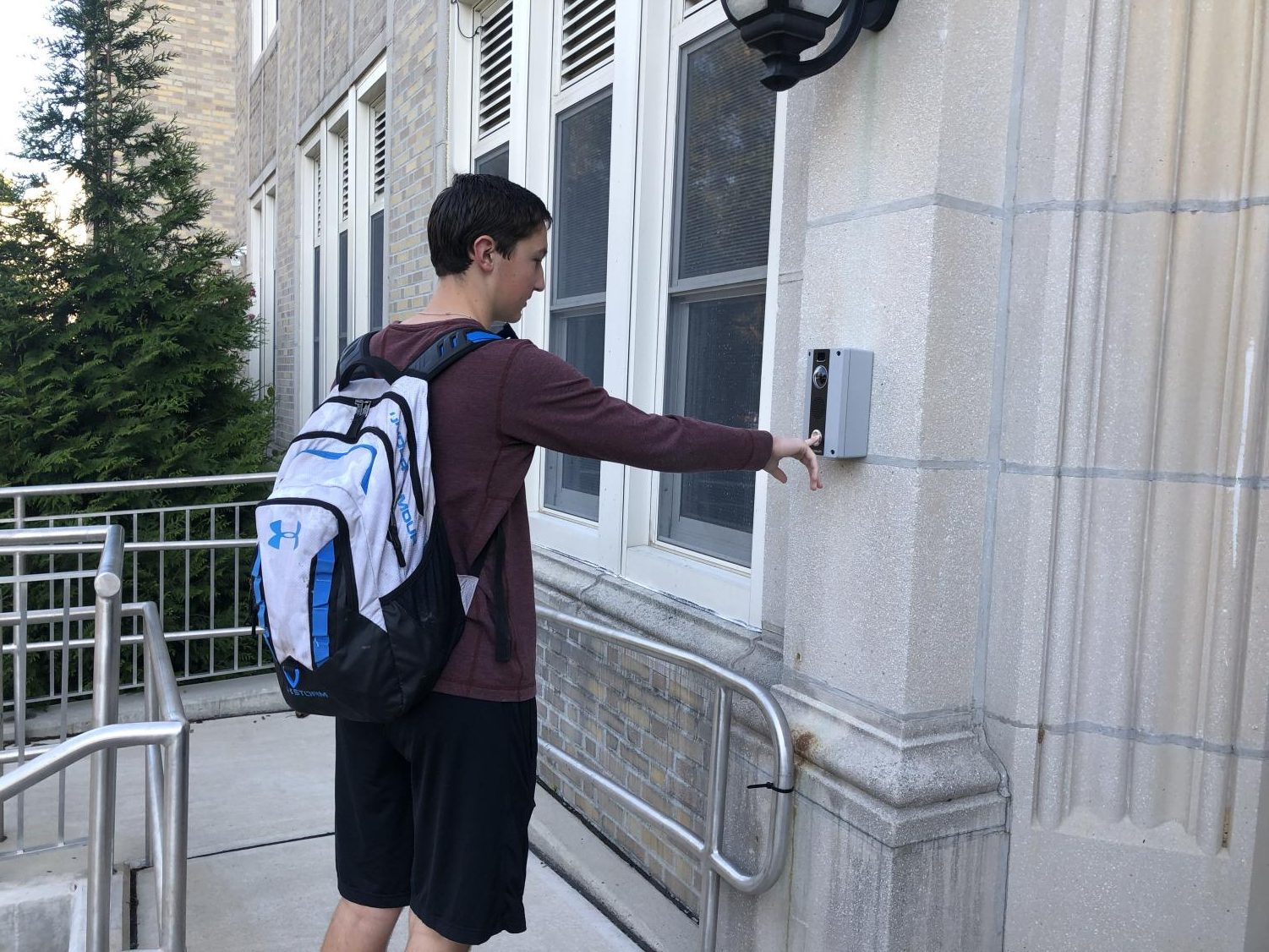 Student has to buzz into school after arriving late.