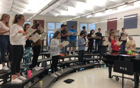 Madrigals in class preparing for their From The Top performance.