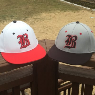 Home and Road caps for the baseball team in the upcoming season.